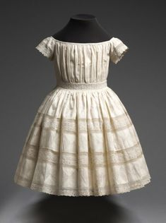 Child's Dress 1850s The Philadelphia Museum of Art REFUGEE CHILDREN ARE DYING EVERY DAY. PLEASE DONATE TO HELP American Red Cross (Canadian) (British) (Australian) Islamic Relief Fund USA Doctors Without Borders/Médécins Sans Frontiers UNICEF UN...