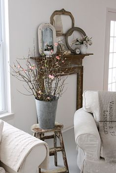has all my favorite things..tin, great linen,faux chippy mantel, old clock, white pitcher and, of course, white....