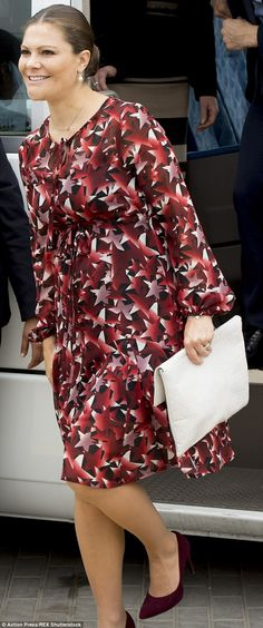 The 38-year-old heir to the throne accessorised with elegant pearl drop earrings, a white envelope clutch and burgundy high heel pumps