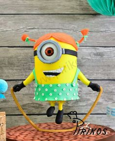 Minion cake suspended on a rope