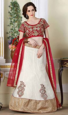 Amass compliments wherever you go dressed in this white color embroidered net choli skirt. This gorgeous attire is showing some extraordinary embroidery done with lace and resham work. Upon request we can make round front/back neck and short 6 inches sleeves regular choli blouse also. #PerfectBestCombinationLehengaCholi