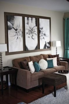 I love the three black and whites mounted on the brown board above the couch. Just awesome.