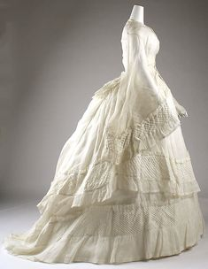 Wedding dress Date: 1873 Culture: American Medium: cotton Dimensions: (a) Length at CB: 26 in. (66 cm) (b) Length at CB: 55 in. (139.7 cm) (c) Length at CB: 44 1/2 in. (113 cm) Credit Line: Gift of Helena I. Redford, 1950 Accession Number: C.I.50.6a–c
