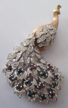 Offered for auction is this vintage 1940's Benedetto Panetta Rhinestone and jeweled peacock brooch. Overall condition is very good with no major flaws to note. No missing or chipped stones.