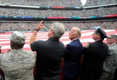Eagles coach Doug Pederson, left, points to the fighter jets flying over the stadium as he holds an American Flag with Vice President Joe Biden before a game vs. the Cleveland Browns at Lincoln Financial Field in Philadelphia, Sunday, Sept. 11, 2016. (Tim Hawk | For NJ.com)