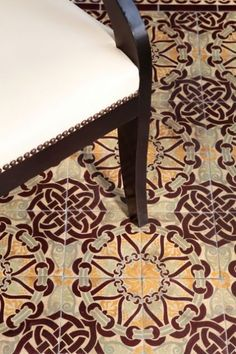 """""""I love the idea of using Moroccan patterns on the floor. Here a beautiful encaustic tile (a ceramic tile in which the pattern is not a product of the glaze but of different colors of clay) is used with neutral furniture for a global-modern vibe.""""  Houzz"""