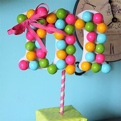 Here's a sweet and easy idea for DIY party decor, courtesy of Joyful Scribblings:gumball monogram topiaries! Made of just a few simple materials, they come together in a snap, and the candy makes them perfect for a birthday party. To make a topiary, you need: ...
