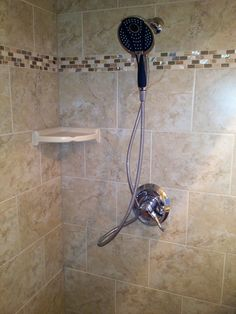 Riverview, Florida master bath tile using 10x13 wall tile and a mixed mosaic of travertine, glass & mother of pearl.