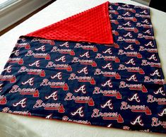 All right, fans! Get ready to cheer on the home team with your youngest fan with this Atlanta Braves Minky Baby Blanket! Lovey Blanket, Toddler Blanket, Minky Baby Blanket, Baby Girl Blankets, Handmade Baby Gifts, Baby Boy Gifts, Gifts For Boys, Baby Shower Gifts, Baseball Baby Blanket
