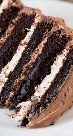 Six-Layer Chocolate Cake with Toasted Marshmallow Filling Malted Chocolate Frosting