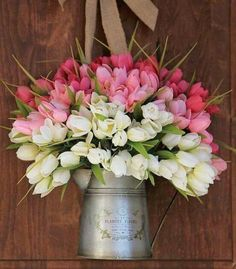 Flowers in an old glass or metal jug can add a nice rustic touch to any Easter flower arrangement.
