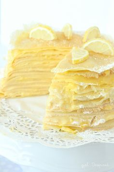 Lemon Crepe Cake - a tower of crepes, unbelievably dense, layered with pastry cream and lemon filling- warm the slices in the microwave for a minute - these are not great when cold. Lemon Desserts, Lemon Recipes, Just Desserts, Sweet Recipes, Cake Recipes, Snack Recipes, Cooking Recipes, Snacks, Crêpe Recipe
