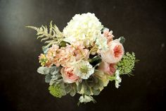 Bridal bouquet. Peach juliet garden rose, hydrangea, succulents, white scabiosas, pink stock flowers and lambs ear. Gorg!