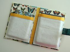 Another great Kindle cover -- this one made from a blank journal with a pretty cover. The internal pockets are made with fleece, but as I've seen fleece tear,  I think I'd choose felt instead.
