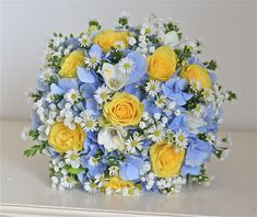 bouquet with light blue hydrangeas and yellow roses