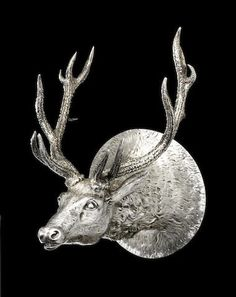 An impressive Victorian silver stirrup cup, finely cast as a stag's head by John Samuel Hunt, London 1847