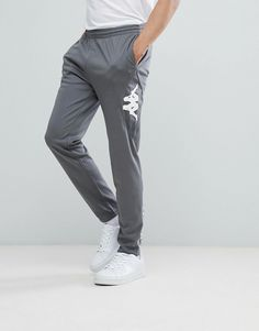 Get this Kappa's joggers now! Click for more details. Worldwide shipping. Kappa Biella Logo Joggers - Grey: Joggers by Kappa, Elasticated waistband, Functional pockets, Omini logo to sides, Kappa branding to reverse, Zipped cuffs, Regular fit - true to size. Founded in 1916, Italian streetwear legends Kappa have come a long way since first launching as a sock and underwear brand. Merging their �Omini� logo with functional and technical know-how has made them the go-to brand for FC Barcelo...