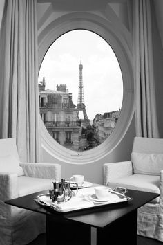 Room with a view ~ Parisian style!  the beautiful Eiffel tower framed through an amazing oval window at the Radisson Blu Le Metropolitan Hotel, Paris Eiffel
