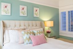 Feminine bedroom design with tufted headboard gives texture and interest in this room.