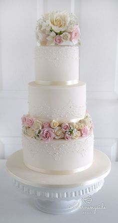 3 tier wedding cake with edible lace, sugar rose bouquet and rose buds separator. #weddingcakes