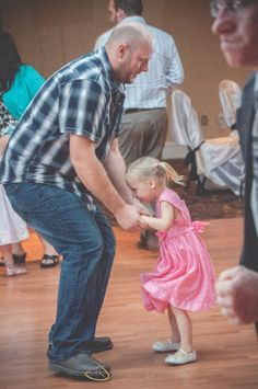 Dad dancing with young daughter | Shalene is an Edmonton based photographer who specializes in wedding photography. Her photos are simple and elegant with a vintage style feeling.