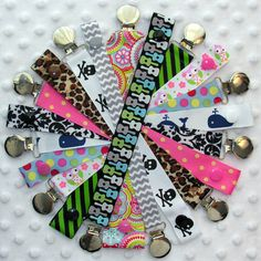 Hey, I found this really awesome Etsy listing at http://www.etsy.com/listing/66178154/3-soothie-pacifier-clip-strap-holders