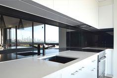 Black glass splashback reflects the city skyline   VIVANT GLASS