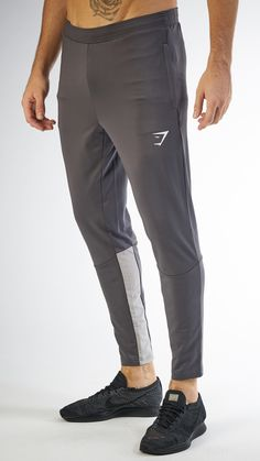 With an improved fit, lightweight material and soft touch fabric, the Men's Reactive Bottoms are a workout wardrobe staple. Coming soon in Charcoal and Light Grey. Track Pants Mens, Mens Jogger Pants, Workout Gear For Men, Workout Wear, Joggers Outfit, Running Pants, Mens Fitness, Fitness Fashion, Windbreaker
