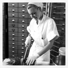 Pastry Assistant Sarah Hummer tears through a pineapple for our fresh pineapple ice cream topping.