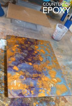 Purple, Turquoise, and Gold resin sample created at the July Resin Workshop by Levi Comstock!
