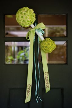 Baby rattle with child's name on ribbon - door decor! Love this! :D Could use Styrofoam balls and cover with faux flowers...very inexpesive and easy! Shower Doors, Baby Shower Decorations, Baby Shower Themes, Baby Showers, Shower Baby, Baby Shower Parties, Baby Boy Shower, Baby Shower Gifts, Bridal Shower