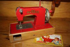 Vintage toy sewing machine. Mine is green.  Still have it.