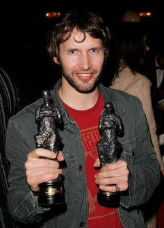 James Blunt poses with the two Awards he received at the 51st Ivor Novello Awards at the Grosvenor House Hotel on May 25 2006 in London England. Credit: Dave Hogan