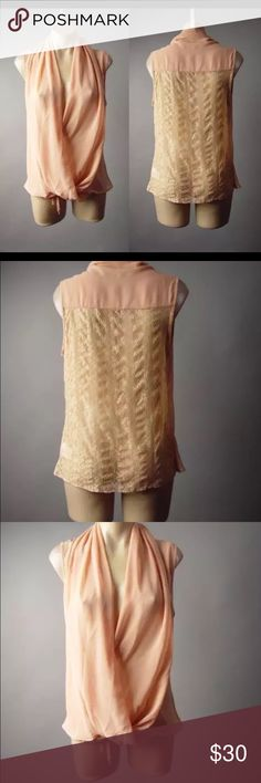 Ryu Blush Wrap Crossover Plunge Front Sheer Bring an air of classic elegance and graceful femininity to any ensemble with the addition of this refined blouse. An always flattering crossover design delivers a wrap style look, complete with a plunging draped front. Its chiffon fabric is met by a panel of lace in a blush hue for a polished girlishness. Wear this piece over a cami with a slim-fit blazer and a pencil skirt for work. Then try with burgundy skinnies and rose-gold accessories for a…