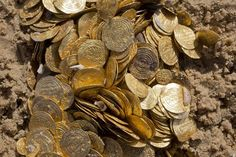a detail of Fatimid period gold coins that were found in the seabed in the Mediterranean Sea near the port of Caesarea National Park in Caesarea, Israel,