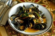 Mussels -This dish is made using some of the finest ingredients including chopped parsley, dry white wine, tomato, crusty bread, mussels, olive oil and garlic clove.