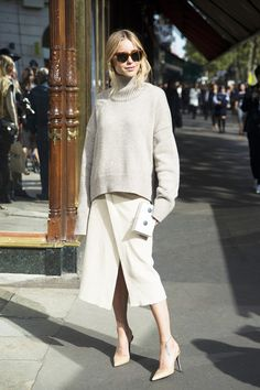 All black takes a backseat when it comes to fashion blogger Pernille Teisbaek's cream-colored outfit.