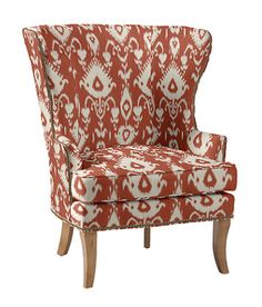 Love the ikat wing chair in burnt orange clay and cream. Great pop of pattern and color for the great room. We could do two matching.