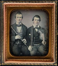 hand-tinted daguerreotype portrait of two gentlemen with their instruments, a flute and a violin respectively