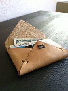 Genuine vegetable tanned leather envelope card & bill holder with 1930's vintage/antique copper number plate. $40.00 USD, via Etsy.-SR
