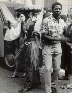 Charlie Phillips - Notting Hill Carnival, Ledbury Road, 1968. S)