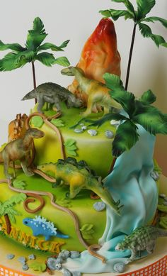 Dinosaurs cake love the details,  Go To www.likegossip.com to get more Gossip News!
