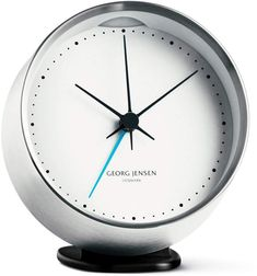 Georg Jensen's Henning Koppel alarm clock is a fine combination of Danish functionality and style. Designer legend Henning Koppel's clocks were published already in and due to their timeless elegance, the clocks were later re-introduced by Georg Jensen. Contemporary Clocks, Contemporary Design, Modern Design, Analog Alarm Clock, Vintage Alarm Clocks, White Clocks, Grands Vases, Steel Manufacturers, Cafetiere