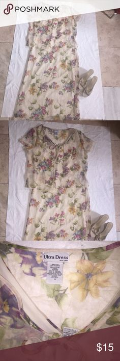Beautiful floral print multicolored Ultra Dress This beautiful floral print ultra Maxi Dress is  a size 14. It has the matching short sleeve shell to go with it as shown in the photo.  This dress has a beautiful lining! Ultra Dresses Maxi