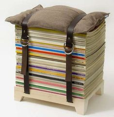 NJUStudio magazine stool makes it easy to collect, stack, and relax