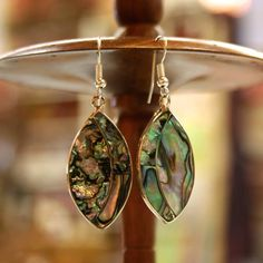 Fair Trade Ellipse Abalone Earrings - Mexico - These earrings are cast from fine alpaca silver. The design features a vertical ellipse filled with iridescent abalone, the blue-green interior of the abalone sea snail shell.