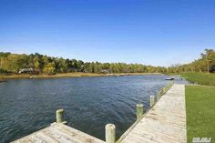 Pin for Later: The Inside Scoop on Anderson Cooper's Hamptons Home  It's not a vacation home without a private dock, right? Source: Redfin