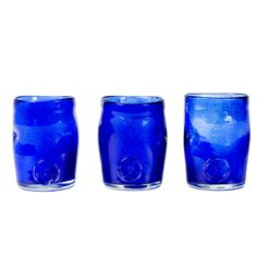 Crafted by hand, this stunning glass tumbler features a classic design and coloured finish that may vary slightly between products. Perfect for serving individual desserts at dinner parties or drinks in the garden. Product: Set of 3 tumblers. Dimensions: 10-13cm. Note: Due to the handmade nature of this product please expect slight variations in colours.