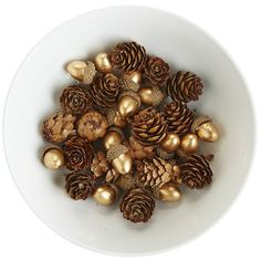 When decorating for fall, our festive table scatter is a nice alternative to gathering pinecones. Toss them around a harvest centerpiece for a pinch of panache, and you're golden.