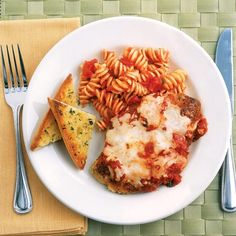 Cheesy Chicken Parmesan  This dish was very, very yummy. Don't worry about cooking chicken all the way through when frying it. It will finish cooking in the oven.